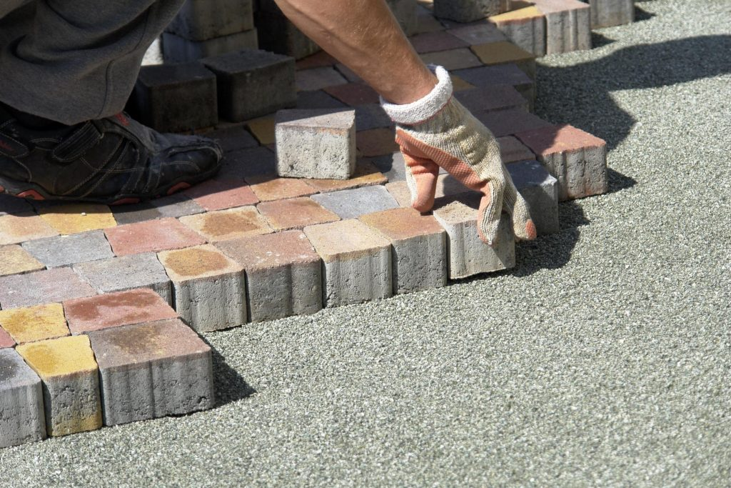 paving masonry worker doing stone paving